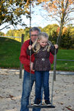 At playground with grandpa Stock Images