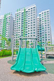 Playground within high-rise residential estate. A playground within a high-rise residential estate royalty free stock photo