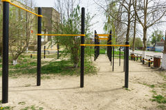 Playground with a horizontal bar on a city street Stock Image