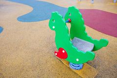 Playground horse with colored rubber flooring Stock Photos