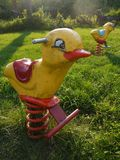 Playground: retro kids ride chickens Stock Images