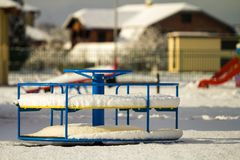 Playground in kindergarten for children in winter with snow cove Royalty Free Stock Image