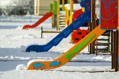 Playground in kindergarten for children in winter with snow cove Stock Image