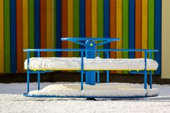 Playground in kindergarten for children in winter with snow cove Royalty Free Stock Photography