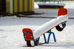 Playground in kindergarten for children in winter with snow cove Stock Photo