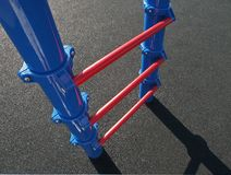 Playground Ladder. Children's climbing ladder rising out of rubberized surface on a school playground Stock Photography