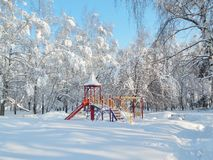 Playground, landscape, snowfall, snow on the trees, blue sky. Winter landscape snow on on tree branches, blue sky Stock Photos