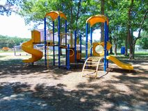 Playground. Large piece of playground equipment in yellow and blue royalty free stock photo
