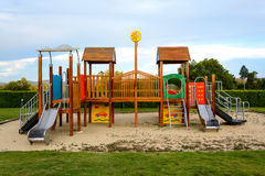 Playground and lawn with blue sky Stock Photos