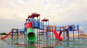 Playground and lawn with blue sky, Childhood Stock Photography