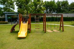 Playground with lawn at village Stock Photo