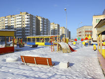 Playground and new multi-storey buildings. Royalty Free Stock Image