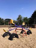 Seesaw on sand for children play in the playground city park. stock photos
