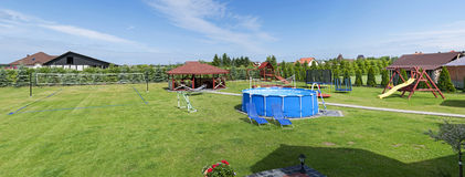 Playground - panorama. Backyard panorama. Outdoor swimming pool, playground and other fasilities Royalty Free Stock Images