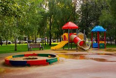 Playground in park. Empty Playground in park after a rain Stock Image