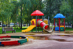 Playground in the park. Empty Playground in the park after a rain Royalty Free Stock Photo