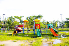 Playground park on grass near school is children Stock Photography