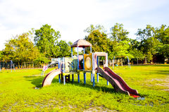 Playground park on grass near school is children Royalty Free Stock Photography