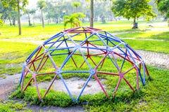 Playground park on grass near school is children Stock Images