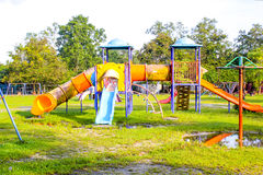 Playground park on grass near school is children Stock Photo