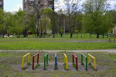 Playground in the park with green trees in a dormitory area. In Kharkiv, Ukraine royalty free stock photos