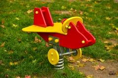 Playground plane swing Royalty Free Stock Photography