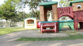 Playground and play equipment wait for some kid come to play it. stock footage