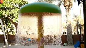 Playground by the pool, with fountains. Waterfall from a fountain cascading.  stock video