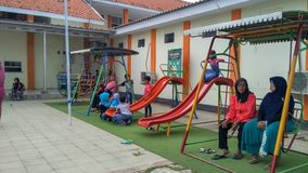 Playground in public area, childrens in sunny summer holiday. stock images