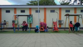 Playground in public area, childrens in sunny summer holiday. stock photo