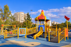 Playground in public park. Colorful playground for children. Stock Photos