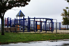 Playground On A Rainy Day. This playground with all it`s winding mysteries seems to be waiting for all the children to come out and play in the rain. With water stock images