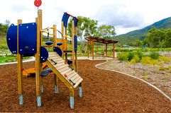 Playground in residential area. A playground for children found in a new residential area nestled in around landscaping and covered picnic area stock images