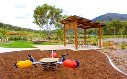 Playground in residential area. A new playground for children with landscaping, gum trees and covered picnic area found in a brand new development site stock photo