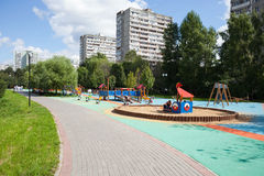 Playground and residential buildings Stock Photos