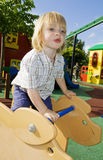 Playground ride and child Stock Photo