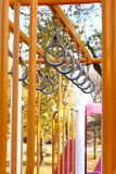 Playground Rings. A row of climbing rings hanging from a jungle-gym style playground Stock Photos