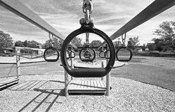 Playground rings. Climbing rings on a school playground, in grainy black and white Stock Photos