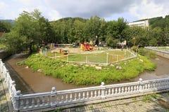 Playground and river Belokuriha Royalty Free Stock Image