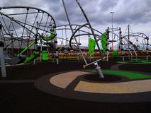 Playground with rubber floor covering stock images