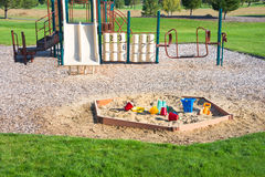 Playground Sandbox Toys Jungle Gym. Jungle gym and sandbox with plastic toys in playground. Copy space Royalty Free Stock Photography