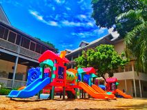 Playground in the school. A playground, playpark, or play area is a place specifically designed to enable children to play there. It is typically outdoors Stock Photography