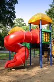 Playground Set with Slide. A playset with slide in a sandbox in a park Stock Photo