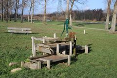 Playground with several water play tools and pull ferry over ditch in the public park Hitland in Capelle aan den IJssel in the Net. Herlands stock photos