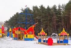 Playground site for kids, winter scene. Big children playground site with various equipment in winter Stock Photo