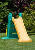 Playground slide. Little plastic slide on playground royalty free stock photography