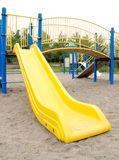 Playground Slide. A blue and yellow playground slide Royalty Free Stock Images