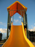 Playground Slide. Summer fun at the playground slide royalty free stock image