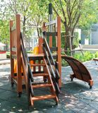 Playground Slide and Climber in A Park. Children Playground, Slide and Rope Climber in Outdoor Park Stock Photo