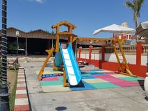 Playground slide for kids inside of the restaurant. Playground in the restaurant royalty free stock images